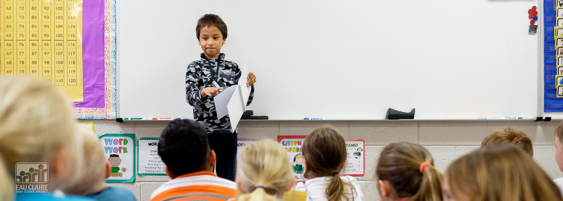 Young Author Reading to His Classmates